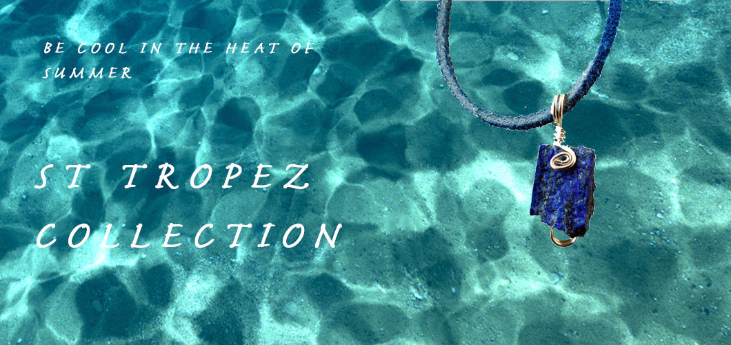 Image showing fine sand in shallow blue seawater in the background. Rough Lapis pendant and launch info for St Tropez Collection. Calico Rose Studio.