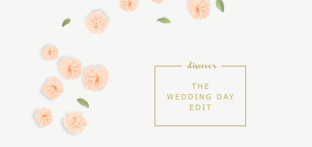 Image of scattered paper flowers with discover the wedding day edit