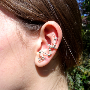 Image of Rose-Quartz-ear-cuff-handmade by-Calico-Rose-Studio. Shown in the ear