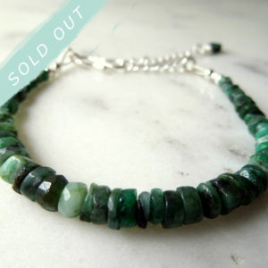 Image of emerald tennis bracelet handmade by Calico Rose Studio with sold out strap across