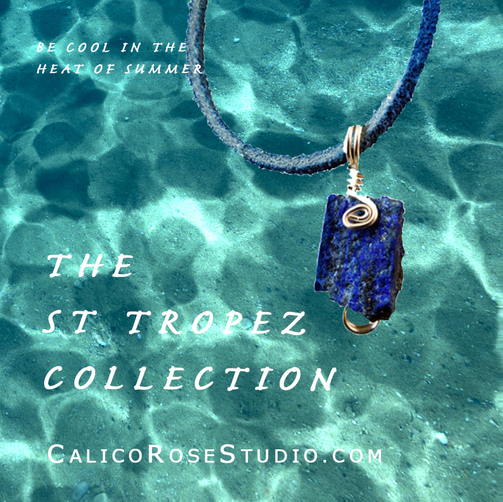 Image of raw Lapis pendant with a background of shallow blue sea. St Tropez Collection Calicorosestudio.com. Be cool in the heat of the sun.