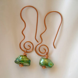 Photo of Green-keshi-pearl-earriings-handmade-by-CalicoRose-displayed-in-a-ceramic-shell-dish