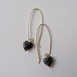 Photo of Larvikite-heart-shaped earrings-handmade by Calico Rose Studio flat lay