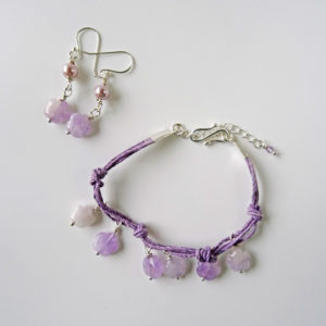 Photo of amethyst-flower-bracelet-and-earring-set-table-top-view