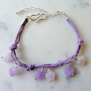 Photo of amethyst-flower-bracelet handmade by-Calico-Rose-Studio table top shot