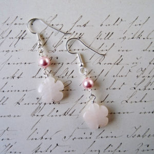 Photo of pink-flower-earrings-handmade by Calico Rose Studio shown on a page of vintage handwriting