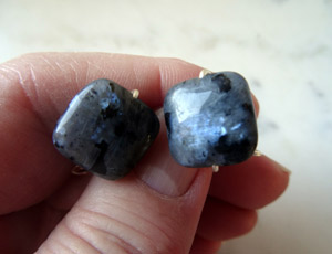 Photo of Larvikite-cufflinks-handmade-by-calico-Rose-Studio,-showing-the-mysterious-blue-shimmer-inside-the-stones