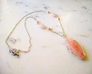 Photo of Rose-quartz-Marquise-pendant-handmade-by-Calico-Rose-Studio-table-top-view