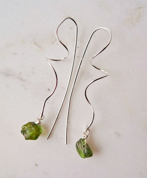 Photo of raw-peridot-earrings-hand-forged-long-silver-earrings-Calico-Rose-Studio